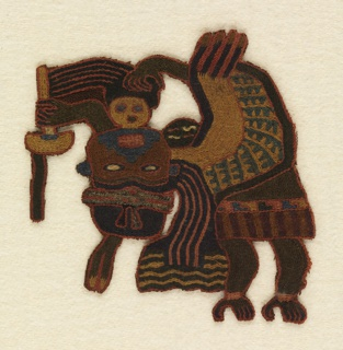 Flying or floating masked human figure holding a wand or a fan and a trophy head.  Embroidered in strong colors of deep brown, tobacco brown, blue, red, and ochre.