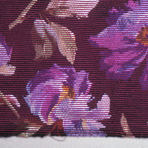 Heavyweight silk with horizontal ribbing has large-scale multicolored pansies scattered over a dark brown ground.