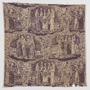 Cotton fabric printed with four vignettes of groups of women in Norman costume with large headdresses. Floral sprays and the words Costumes Normands in the interstitial spaces.