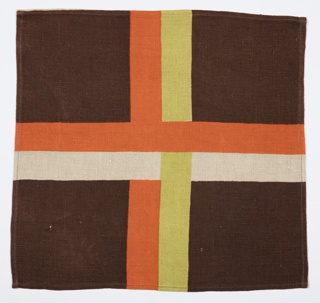 Tablecloth in green/orange colorway, one napkin in brown/orange colorway