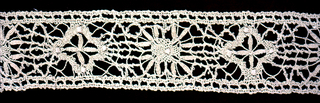 Band of lace worked in a provincial style with a pattern of geometric star shapes.