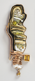 An abstract brooch in a vertical orientation with black, light green, gold, and beige enamel above an applied square citrine on the lower right and pearl details at bottom.