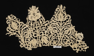 Collar fragment with symmetrical plants forming pointed tabs.