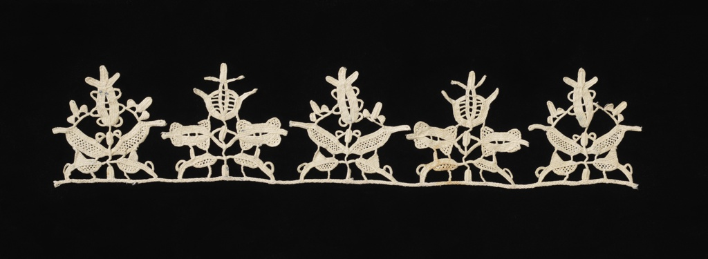 Border of five pendants showing stylized floral forms.