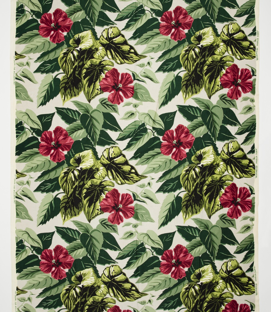 Printed length with a large repeat of a leafy hibiscus plant with bright red flowers and leaves in multiple shades of green on a pale gray ground.