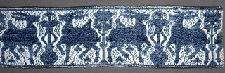 Band from a Perugia towel with a pattern of a fountain with confronted stags.