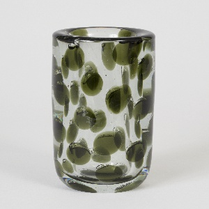 Cylindrical vase of thick-walled clear glass with internal decoration of green discs, many topped by a small air bubble; tapered circular base.