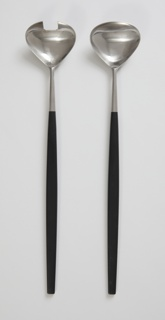 Set of two stainless steel salad servers, one with two broad, shallow prongs and the other with oval bowl; black nylon handle has thin rounded contours