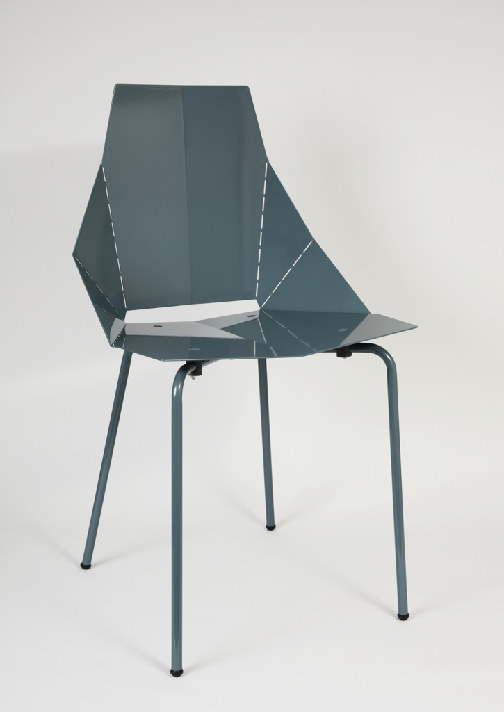 Angular body of chair in perforated sheet metal; origami-like construction with legs of bent tubing