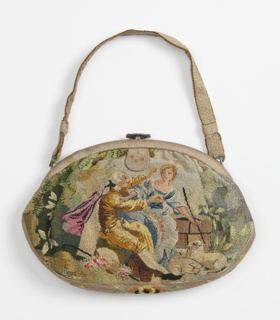 Oval handbag of linen solidly worked in petit point in multi-colored silks. Man offering flowers to a shepherdess, both in 18th century dress. Back has a floral design.