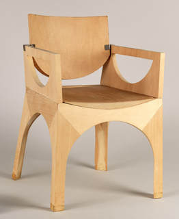 Wood form with pivoting back. Arched legs, semicircular cutouts in arms; back, with round lower section.