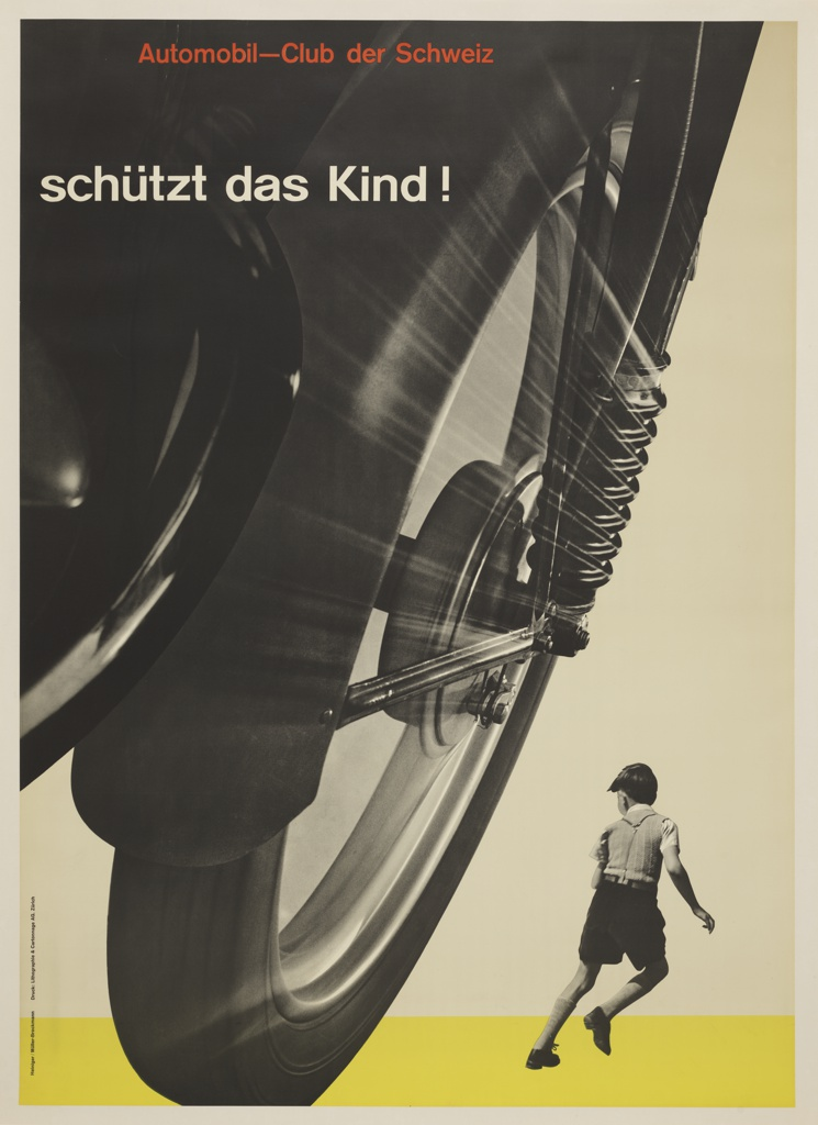 "Black and white photographic image showing a huge motorcycle wheel in left foreground, and a smaller image of a young boy running (seen from behind), in the lower right corner. In order to promote traffic safety, the poster is designed so the vehicle tire threateningly appears to be about to run over the child.Text in red Akzidenz Grotesk type face at upper left: Automobil-Club der Schweiz (Automobile Club of Switzerland); below in white Akizidence Grotesk: "" Schüzt das Kind!"" Yellow ground across bottom edge."
