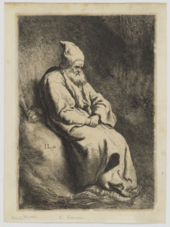 A robed figure seated in a darkened space, seen in 3/4 view, hands in lap.