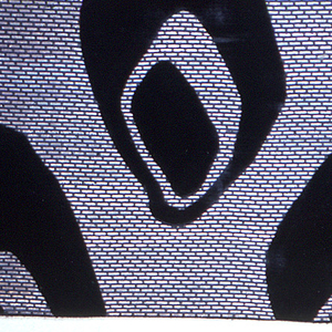 Large scale staggered horizontal repeat of two black concentric ovoid shapes in a ground fabric shot with silver.
