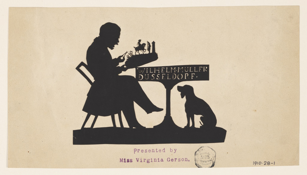 Seated figure of a man sitting at table, facing right, in act of cutting a silhouette. Dog seated below table.