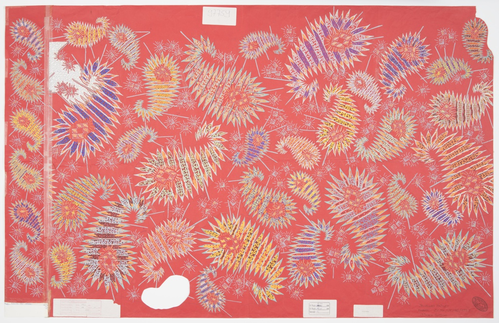 """Textile design featuring a paisley pattern in yellow, orange, purple, green, white, black, and grey on a pink ground. The individual paisley """"cones"""" or teardrop shapes are different sizes and are positioned in different directions. The borders are outlined in grey with repeating triangles, giving them a """"spikey"""" appearance. Grey diagonal lines emerge from the paisley motifs, and grey small squares or cubes, with small diagonal lines radiating from them, are scattered across the composition."""
