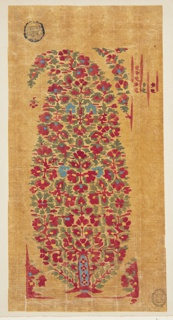 A paisley motif, also referred to as a Persian cone, is formed by multiple flowers and green leaves grouped closely together. Although the flowers are mostly red with yellow centers, some are blue (also with yellow centers). A floral framing motif is at the bottom, and a garland is positioned beside the motif on the upper right. Red vertical stripes, with what appears to be parts of flower blossoms and leaves between them, appear to the right of the garland.