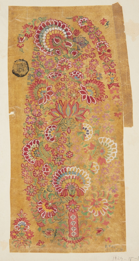 A paisley motif, also referred to as a Persian cone, is formed by flower blossoms of various sizes and colors (pink, red, yellow, blue) and a few green leaves and stems. A red rectangular base decorated with flowers is at the bottom center of the composition. Beside the motif, a cluster of flowers and two red blossoms appear; a flower garland and a red blossom are at the right top. The lower right part of the design appears unfinished, with some of the flowers only outlined in white.