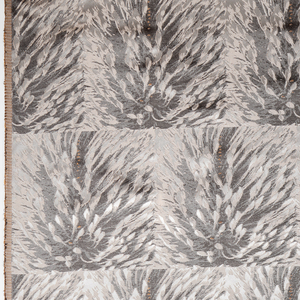 Finely woven silk with repeating pattern of banksia plants in shades of gray, with touches of orange.
