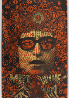 "Large, central image of Bob Dylan in metallic gold and red, with singer wearing glasses containing text: ""Blowing in the Mind"" in metallic red. This portrait contains multi-sized radiating circular patterns in Dylan's hair, also in metallic gold and red. Additionally, portrait contains motifs from Albrecht Durer's series of woodblock prints for embroidery patterns, located in the middle of the singer's forehead as well as between circular patterns in upper section of poster. Also features a smaller image of Dylan in profile in the poster's lower section, in metallic red, facing left, in front of text: ""Mister Tambourine Man"" in metallic gold."