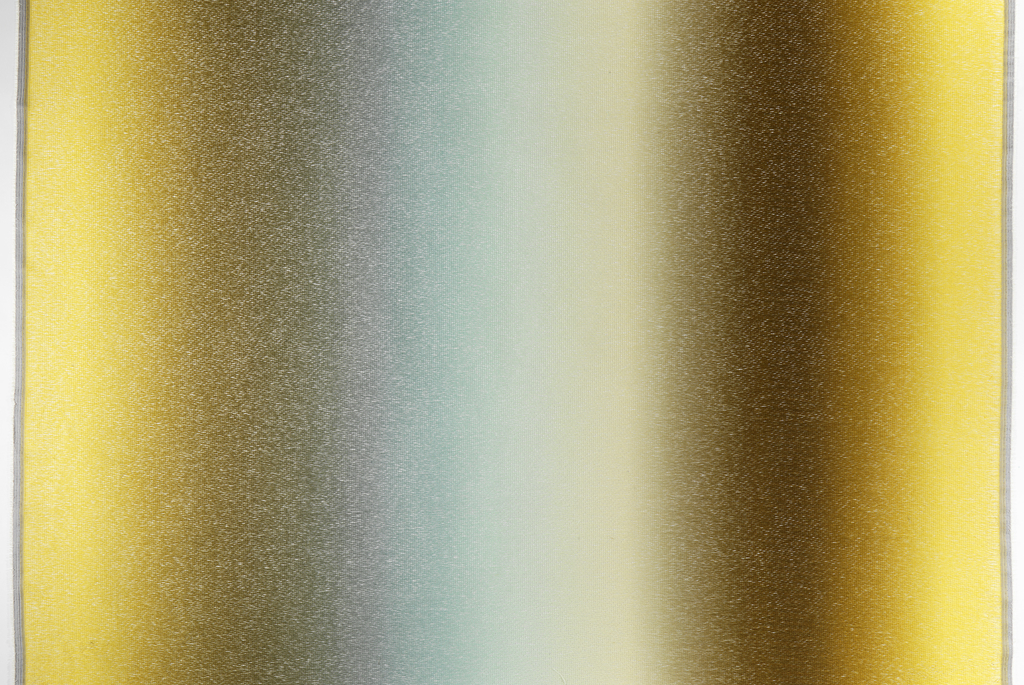 Length of digitally-printed fabric with vertical columns of yellows, browns and blues bleeding into one another extremely gradually (ombré). Sold as drapery fabric.