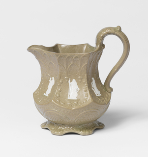 Low footed octagonal pitcher in gray-tan with white classical figures applied to each facet. All over Gothic-style pattern decorating body.