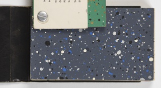 """A multitude of color variations featuring """"spattered"""" designs, with different colored pigments spattered on many different ground colors. A few repeat patterns are included in the back of the book, including Chinese Tea Chest papers. a) Contains Tea chest papers; b) contains pepper pot papers; c) contains a variety of papers including pepper pot papers and flocks with sparkles."""