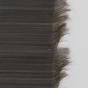 Dark brown horse hair is used end to end as the weft, with several inches left unwoven at each side. Panel has subtle variations in color created by slight differences in the shades of horse hair used.