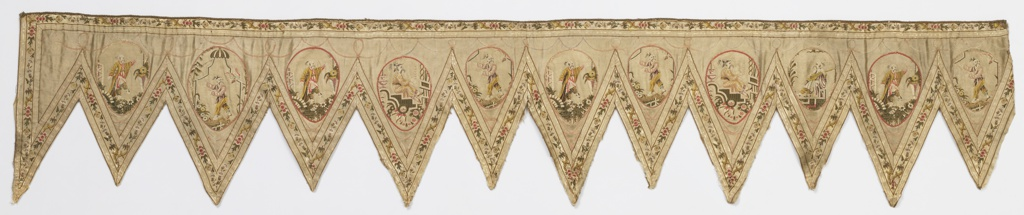 Valance with triangular tabs. Applied ivory ribbon with flowers trims all of the tabs and the top of the valance. Each tab has an egg-shaped appliqué which contains a single brocaded chinoiserie figure. Applied pink linear trim. The entire piece is lined and backed with coarse linen.