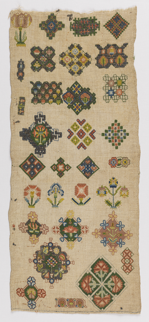 'Spot' sampler with individual motifs of geometric interlacings and flowers embroidered in metallic threads and colored silks with some deflected element work, on a natural linen ground.
