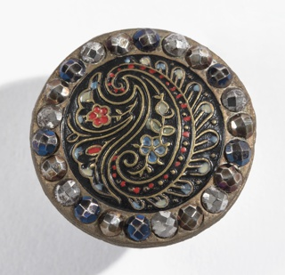 (a) Brass button with design resembling Persian Cone stamped and painted in color, surrounded by facetted boses of cut steel in various colors; brass shank. 