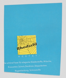 "Advertisement for Rhodiafil, a company that appears to specialize in acetate fabric. Contains a yellow box at lower left containing a spider's web, with ""Rhodiafil"" printed across in black. ""ACETAT"" is printed below in white. The background is blue. Printed in white, along the bottom: Die schöne Faser für elegante Kleiderstoffe, Wäsche, / Krawatten, Schals, Gardinen, Steppdecken, / Regenkleidung, Schirmstoffe (The beautiful fiber for elegant dress fabrics, underwear, ties, scarves, curtains, quilts, rainwear, umbrella fabrics)."