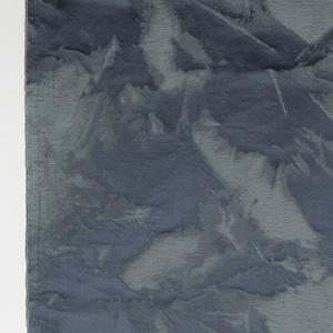Subtle monochrome pattern in grays gives impression of color unevenly applied due to folding of the substrate.