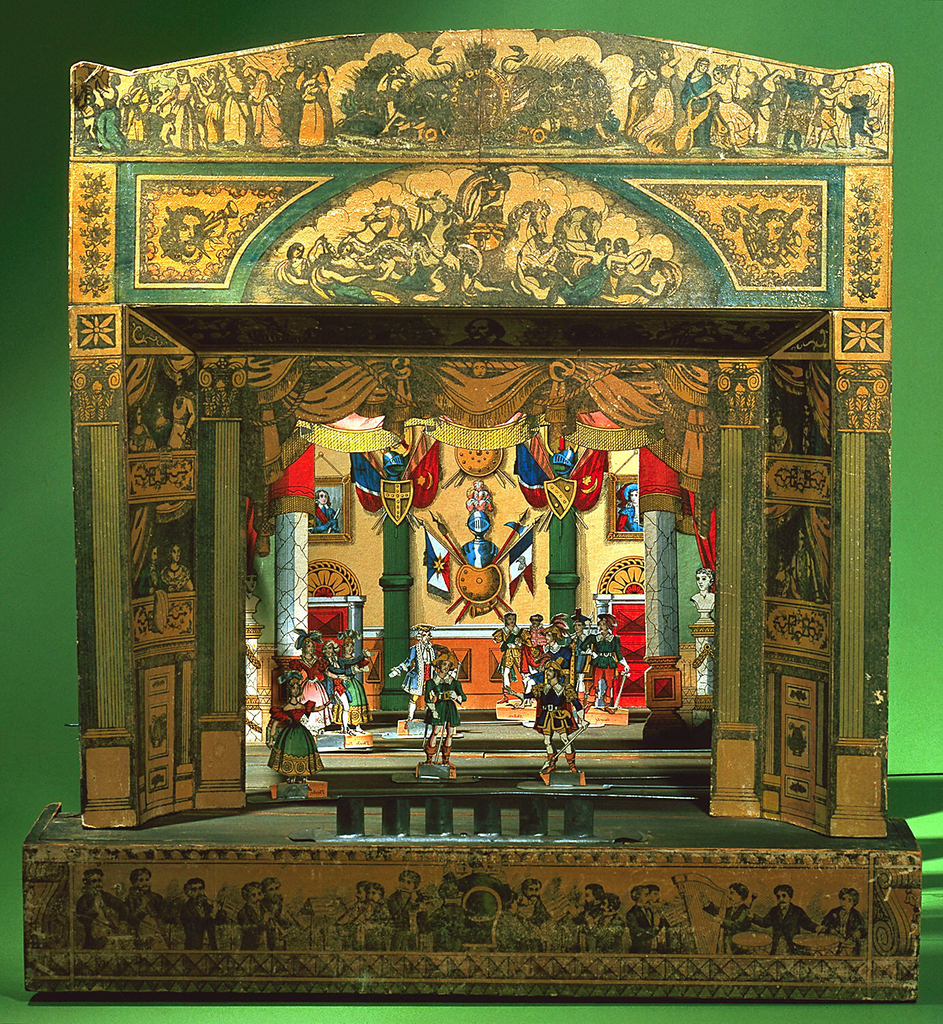 Stage flat, green-stained, with base solid at front and covered with printed and colored paper depicting a theatre orchestra; folding framework attached, with red curtain on roller and strips for holding wings.  Proscenium, printed and colored paper, shellacked, mounted on cardboard backed with thin wood frame; it depicts boxes with spectators, proscenium doors, and across top, British Royal arms, scenes from plays, and Apollo in his chariot, with Muses.  Head of Shakespeare at bottom of proscenium arch.  Red cut-out representation of curtain in opening.  Two separate slides for stage floor, with thumb-grooves.