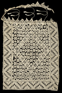 Rectangular cover, probably originally a pillow cover, has tasseled ties on one edge. Central rectangle is made of reticella in a large diamond shape surrounded by small scale geometric motifs. Surrounding border has a zigzag design of needle knotting. Edging at top is bobbin lace.