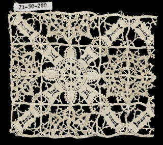 Fragment with a design of a diamond-shaped lattice with rosettes.