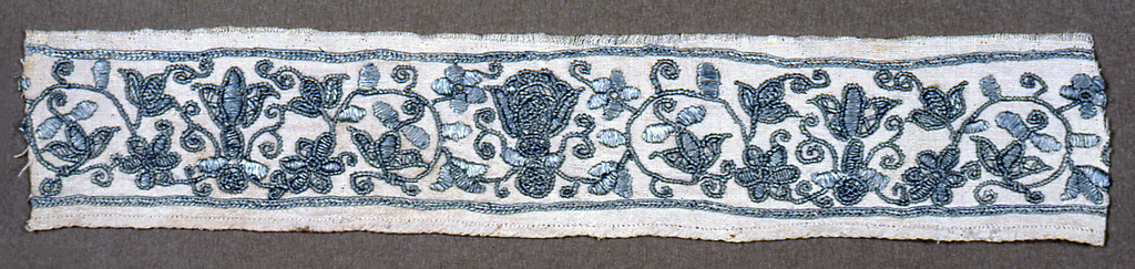 Scrolling floral motifs in blue on white.