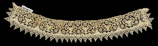 Curved needle lace band of small flower baskets and pointed edge of continuous braid bobbin lace.
