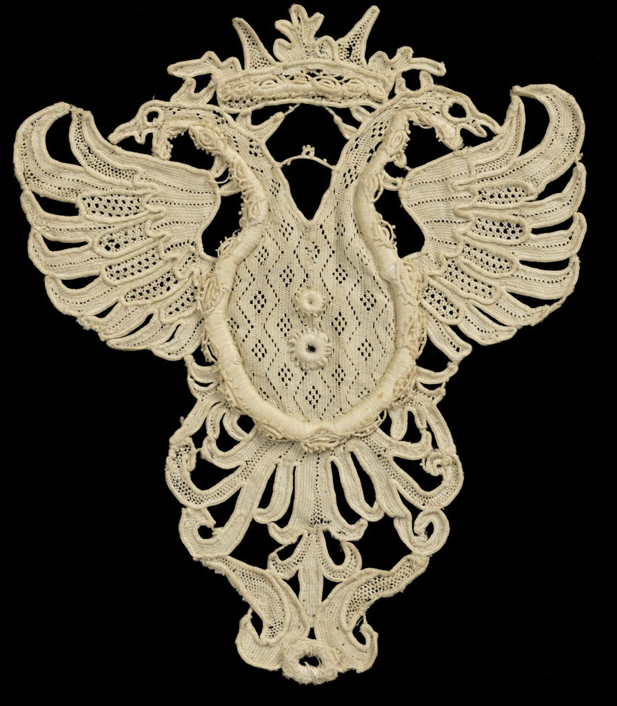 Raised needle lace in a design of a double-headed eagle with a crown.
