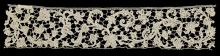 Band fragment with an elaborate scroll and vine with flowers and three-dimensional details.