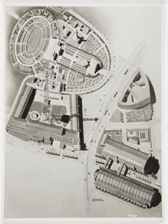 "Black and white photograph showing architectural rendering of Berlin exhibition area. Printed in black, near center left edge: herbert bayer; in white, lower right: 4401; in black, below rendering: BAHNHOF / SWITLEBEN [beside an ""S""]; in pen and blue ink, verso upper right: herbert bayer 1930?; in graphite, verso left edge, vertically: [illegible]; stamped in purple ink, verso lower right: Photogr. Atelier Taubert-Neumann / Berlin-Friedenau / Rheinstraɓe 2 / Tel: H 3 Rheingau 0465; creased right corners and tear at right edge."