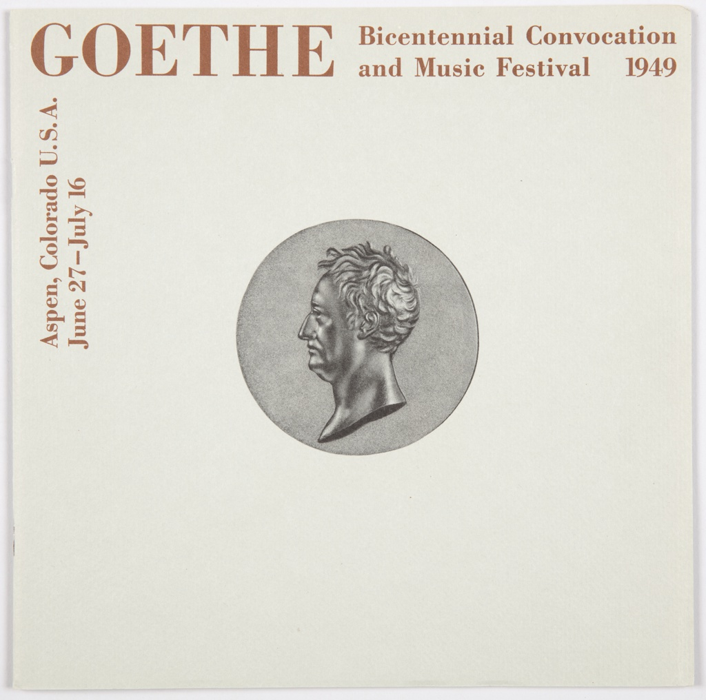 Program for the Goethe Bicentennial Convocation and Music Festival, Aspen, Colorado, June 27–July 16, 1949. Contains a grey front and back cover with maroon printed text. Front cover contains a dark grey medallion in the center with Goethe's face in profile. Printed in maroon, along the top: GOETHE Bicentennial Convocation / and Music Festival  1949; vertically, upper left: Aspen, Colorado U.S.A. / June 27–July 16; text repeats on back cover. Back cover also contains a silhouette of a male figure in elegant clothing with a sword. Endpapers contain a silhoutte of a male figure (front) and printed black handwriting (back). Interior pages contain black and maroon printed text and printed black and white illustrations and photographs.