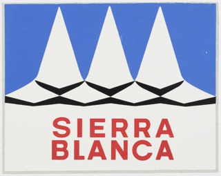 Sierra Blanca sticker with logo designed by Herbert Bayer consisting of three abstracted white triangular mountain peaks with chevron details in black against a blue background. Printed text in red on white background below mountains: SIERRA / BLANCA.