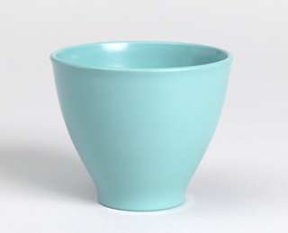 Bowl with flat tapered base and curved sides.