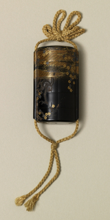 Black lacquer inro, oval in section, decorated with gold waves and flowers. Tied and braided cord.