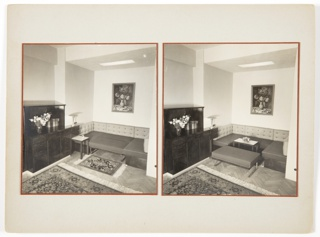 Two photographs of similar living room interiors are mounted next to one another. Both contain couches with detachable parts, a piece of furniture at left with a vase of flowers on top, and a painting with flowers above the couch. The photograph at left consists of two patterned rugs in front of the couch, while the photograph at right features one patterned rug and a small table in front of the couch. A detachable portion of the couch acts as a bench in front of the small table.
