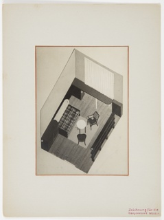 Photograph of a drawing for living room area of an apartment, showing a daybed, two chairs, a round table, and book shelves.