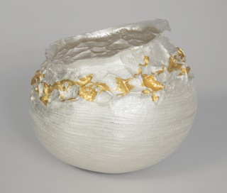 Hand hammered silver bowl with 24k gold leaf applied to the top half of the form.