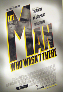 "On metallic grey background, with spotlights along vertical axis, on an incline, appear inscriptions, with the main word (""Man"") filled in with black-and-white photographs of a woman, a man, and another man in a fedora hat, all looking secretive. The title, ""The Man Who Wasn't There,"" is in three-dimensional letters, the face in shades of black, and outlined in red, and the sides in yellow. The other inscriptions, in order of appearance, top-to-bottom, are: ""A film by / JOEL COEN and ETHAN COEN"", ""Billy Bob / THORNTON / Frances / McDORMAND / James / GANDOLFINI"", and credits in small type towards the bottom."