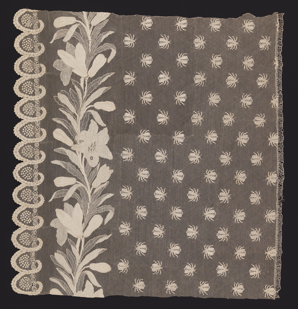 Small piece from a set of bed hangings, with an all-over pattern of off-set bees on a fine net ground. On the left side, a border of  lilies and their foliage. A scalloped edge is formed of gracefully curving laurel branches surrounding clusters of berries.